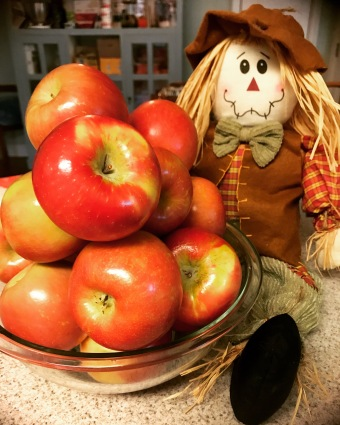 Apples with scarecrow